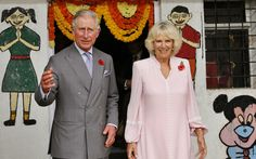 Prince Charles and his wife Camilla, the Duchess of Cornwall, leave after meeting young children at a mobile creche in Mumbai, India