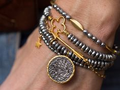 A personal favorite from my Etsy shop https://www.etsy.com/listing/255726156/arrow-bracelet-gold-arrow-bracelet-charm