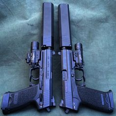 USP Tacticals in .40 and .45, with SureFire lights and SilencerCo .40 and .45 caliber Osprey suppressors.