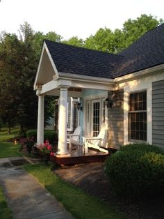 Remodeled ranch. This front door used to be a window. Added portico and porch. Door is painted Moody Blue by Sherwin Williams.#baystreetbungalows #\u2026 & Remodeled ranch. This front door used to be a window. Added ... Pezcame.Com