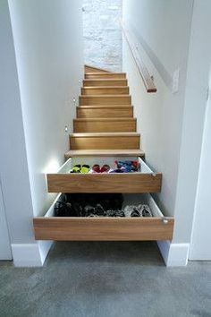 Convert a stair riser into a drawer to additional storage for all your precious shoes.