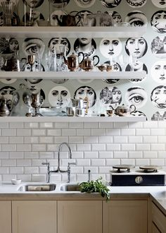 A detail shot of stylist Fiona Richardson's home, featuring Fornasetti wallpaper and a Rohl faucet. Photo: Sean Fennessy via The Design Files. white kitchens