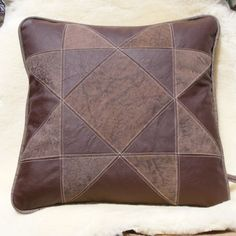 """It incorporates a dark brown smoother leather with a dull finished brindle type pattern    * all leather is the finest upholstery grade    * 18"""" with a Upholstery grade micro suede back complete with zipper closing. $85"""