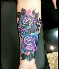 Thinking about getting this is the near future! Purple and blue rose forearm tattoo. Would match my foot tattoo with the colours too!