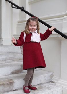 Confident Charlotte beamed for the camera as she posed for pictures on her first day at nursery