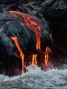 Molten lava flow on The Big Island of Hawaii! Make sure to fly with Blue Hawaiian Helicopters on your next visit! www.bluehawaiian.com