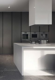 Kitchen With 3 Miele Units Horizontally Placed.