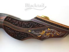 This is a hand-carved, hand-engraved Legacy series bow (by Blacktail Bow Company, LLC).  It is a fully functional, heirloom collector bow.
