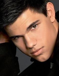 Taylor Lautner...he made me turn from #teamedward in the books to #teamjacob in the movies...he is so freaking hot ;)