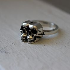 two tiny skulls are better than one. available in sterling silver, yellow gold vermeil(plated sterling silver), or rose gold vermeil.