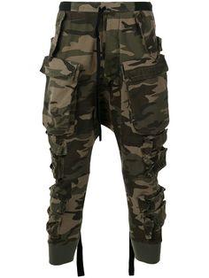 Shop Unravel Project camouflage print track pants.