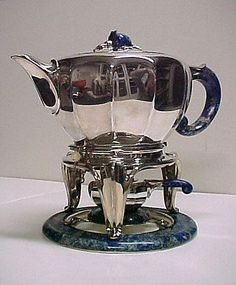 Tea and Coffee Service Jean E. Puiforcat (French, 1897–1945) Date: ca. 1922 Medium: Silver, lapis lazuli, ivory Classification: Metalwork Credit Line: Purchase, Edward C. Moore Jr. Gift, 1925