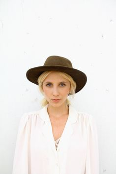 White Blouse & Brown Hat.
