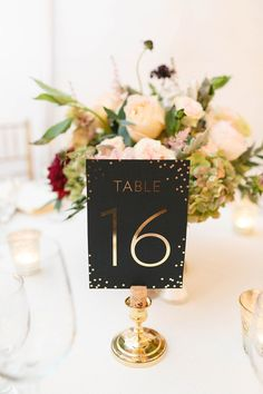 confetti table number - photo by Virginia Ashley Photography http://ruffledblog.com/vintage-glam-rainy-day-wedding