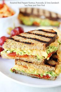 Roasted Red Pepper Hummus, Avocado, & Feta Sandwich Recipe on twopeasandtheirpo. - Roasted Red Pepper Hummus, Avocado, & Feta Sandwich Recipe on twopeasandtheirpo… A simple vegetarian sandwich that is full of flavor! Vegetarian Recipes, Cooking Recipes, Lunch Recipes, Healthy Recipes, Vegetarian Lunch Ideas For Work, Simple Lunch Ideas, Weeknight Recipes, Cooking Cake, Going Vegetarian