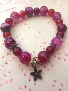 Pink purple and red glass beaded handmade elasticated