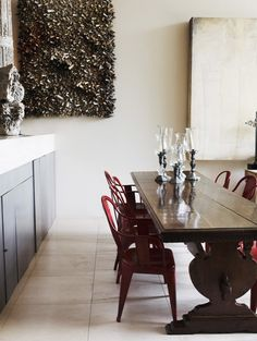 old & new, red Tolix chairs, traditional wood trestle table, tile floors