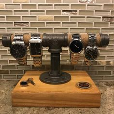 Steel Pipe and Wood Watch Stand Rack Holder Stand (wood nails shelves) Pipe Furniture, Industrial Furniture, Industrial Pipe, Wood Projects, Woodworking Projects, Watch Holder, Watch Box, Wood Nails, Pipe Decor