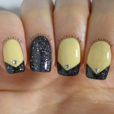 Pale yellow French tip nails.