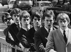 Portrait of English band 'The Yardbirds' leaning on a railing; (L-R) Manager Giorgio Gomelsky, Paul Samwell-Smith, Chris Dreja, Jim McCarty, Eric Clapton and Keith Relf, circa 1965.