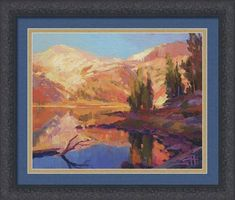 Mountain Lake, peaceful framed art print from Steve Henderson Collections. The surface of the blue, blue lake is still, smooth, reflecting the color of the clear sky above. The trees stand sentinel around the banks. It is a remote landscape of peace and calm, greeting a crisp, cool dawn. In this landscape, one is in no hurry; there are no lists to go through, no work tasks to accomplish. There is rich time to ponder and think. #peaceful #mountain #wilderness #landscape #camping #framedart…