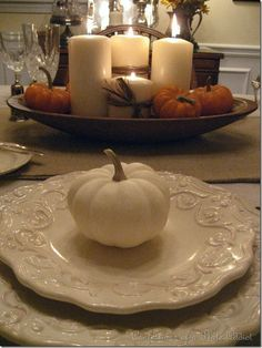 Thanksgiving table setting ... I would use the pumpkins as place cards. Love the idea of candles in a salad bowl.