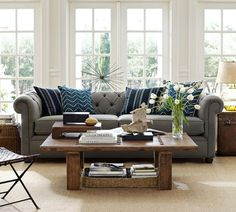 I love the gray, navy and white and wood color scheme going on in this living room!