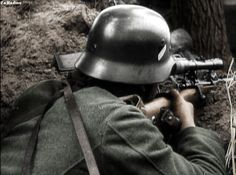 A German sniper with his K98 rifle.