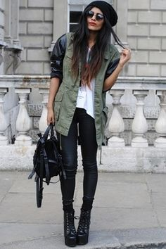 Combo of military jacket and black leather.
