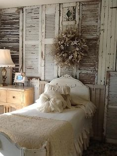 What a seriously cool idea! Making an accent wall out of aged shutters! Talk about country chic! #bedroom #country