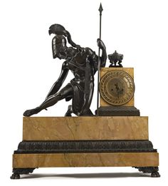 A Charles X patinated bronze and Siena marble large mantle clock circa 1830, dial signed Sironval Jne. a Paris depicting Achilles at battle pulling an arrow from his heel. height 33 in.; width 26 in.. depth 10 1/4 in.