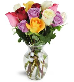 What fun! Colorful and wonderfully fragrant, this cheerfully arrangement will have everything coming up roses!   Over a dozen roses in assorted lovely shades are a perfect surprise for any occasion!