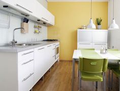 Brighten up the kitchen with a soft yellow accent wall.
