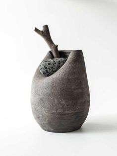 martin azua warped ceramic vase with stone