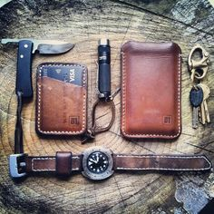 Everyday Carry or EDC refers to small items or gadgets worn, carried or made available in pockets, or bags on a daily basis. This selection is the work of 31trum leather works who custom makewith a ruler, a scapel, a punch, a needle & thread and a penny for the corners. All on his kitchen table in Ealing. (Contact: info@31trum.com )