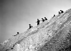 Canadian soldiers of the 6th Infantry Brigade, 2nd Division of The Queen's Own Cameron Highlanders of Canada traverse the steep wall of the Aucrais mines and quarry. The quarry was used by the Germans to store military equipment and trolleys for V-2 rockets. Haut-Mesnil, Calvados, Lower Normandy, France. 10 August 1944.