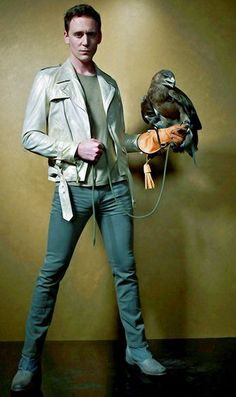 Tom Hiddleston and a hawk. I love this image and those jeans should be illegal hehe