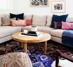 living-room-with-navy-throw-pillows-on-neutral-couch-and-bright-rug