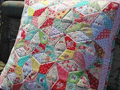Here's the link for the paperpieced block used in this pillow http://pitterputterstitch.blogspot.com/2012/11/paper-pieced-kaleidoscope-tutorial.html#! and it can be adjusted to almost any size for quilt.