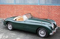 1958 Jaguar XK150S Roadster Chassis no. S830621DN, Engine no. VS1099-9 British Racing Green with Biscuit Interior  This 1958 Jaguar XK150S Roadster is a genuine matching-numbers example that was completed on the 4th of June 1958. It has been restored in its original color combination of British Racing Green with biscuit interior and sand top. In approximately 1984, its most recent owner set about restoring it, a process that included the renewal of the paint, chrome, some of the interior…