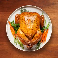 A classic holiday recipe, good any time of the year. Stuff chicken with fresh carrots, celery, red potatoes, onions and thyme for a hearty family meal. Roasted Turkey, Roasted Chicken, Baked Chicken, Lemon Chicken, Chicken Salad, Grilled Chicken, Chicken Recipes, Corn Recipes, Dishes Recipes