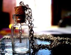 Vintage Style Miniature Cross Glass Vial Pendant. Available from: www.inspirations.mysupadupa.com