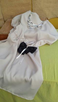 Vestito di mia produzione corto al ginocchio.Anche questa soluzione particolare mi può rendere speciale. ...