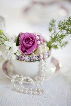 Flowers and pearls in a teacup