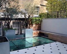 A new landscaped roof terrace with glass floor to light up the basement kitchen below