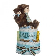 Lil' Baby cakes Dad & Me diaper cake features a sweet daddy bear holding his little cub. Daddy has to change diapers also, so why not introduce him to this new activity of diaper changing with a diaper cake of his own. Lil Baby, Baby Kids, Baby Boy, Diaper Cake Boy, Diaper Cakes, Dad N Me, Daddy Bear, Unique Baby, New Parents