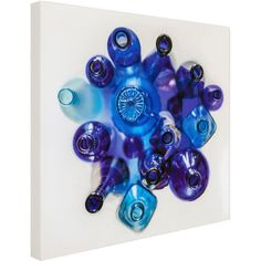 Add a pop of color to your library or above your living room mantel with this chic canvas giclee print, showcasing a blue bottle motif.