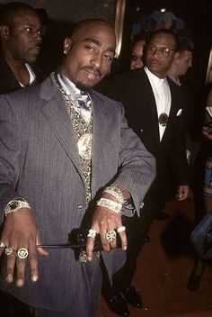Pac peep the rotary ring design on his left ring finger, wow! Don't know nothing bout rotary just look it up
