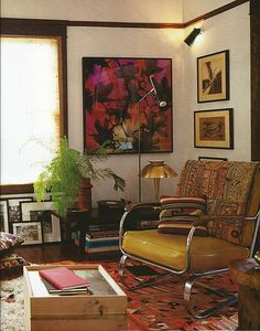 I like the warm tones, the rug and wall art, the mix of textures and textiles though a stronger wall color is more fitting to our home.