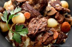 Beef Bourguignon is a flavorful favorite stew made with beef, wine, garlic, onions and mushrooms. It's perfect for making ahead a day too!